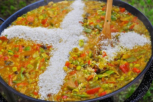 Totally Spain paella rice stirring