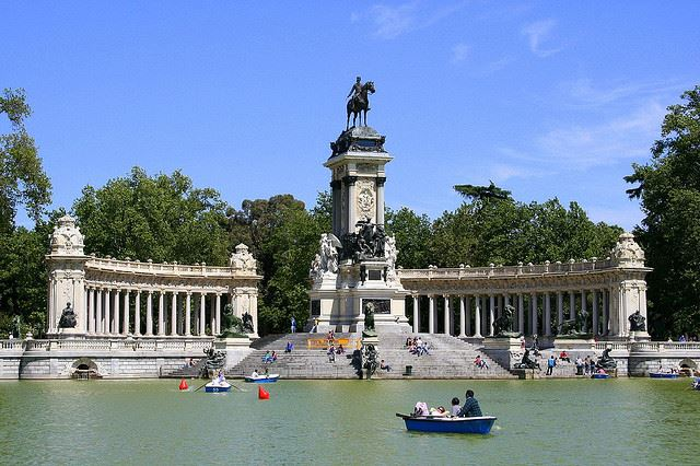 Totally Spain family holidays Madrid rowing Retiro Park
