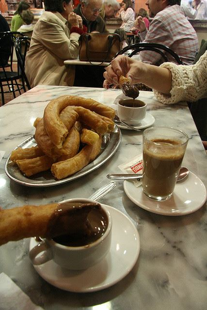 churros chocolate sharing food table spain Sharing food in Spain