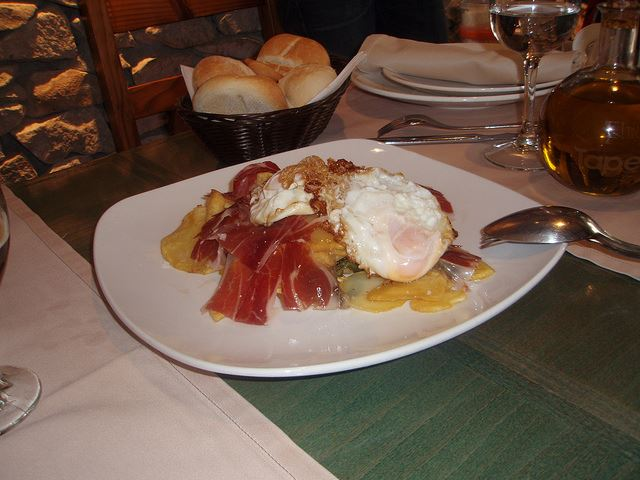 eggs potatoes jamon restaurant Spain Sharing food in Spain
