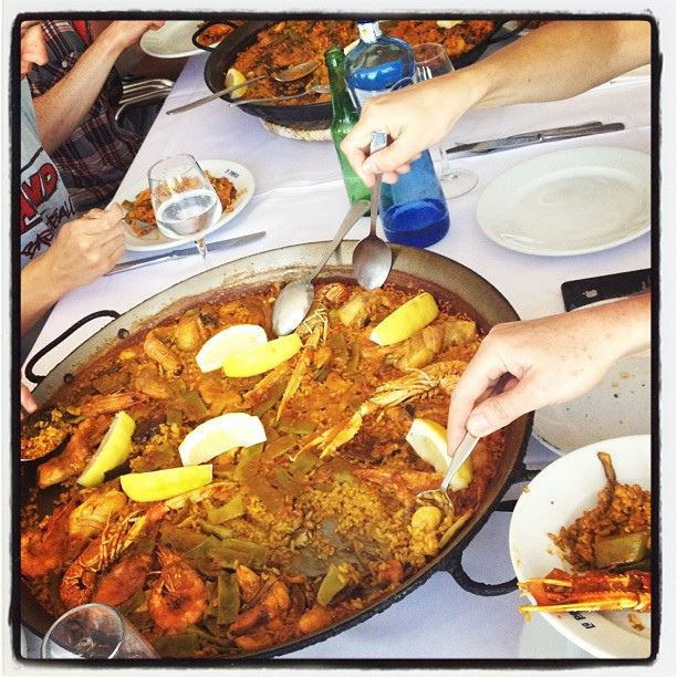 paella rice seafood sharing paellera Sharing food in Spain